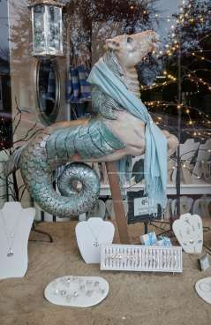 carved hippocampus in shop window